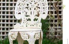 Antique Metal Outdoor Furniture New Retro White Metal Garden Chair With Trellis Background Stock