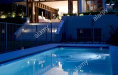 Modern House At Night Luxury Exterior Of Modern House With Swimming Pool Lit At Night