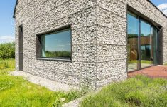 Modern Houses Built With Stone Elegant Modern Pebble Stone Wall House With Large Windows Surrounded