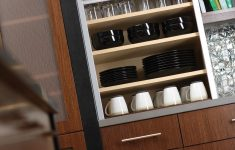 Roll Up Cabinet Doors Unique A Tall Metal Appliance Door Rolls Up Smoothly To Reveal