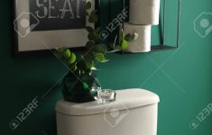 Music Bathroom Decor Elegant Decor Elements Paper Rolls And Toilet Bowl Near Green Wall