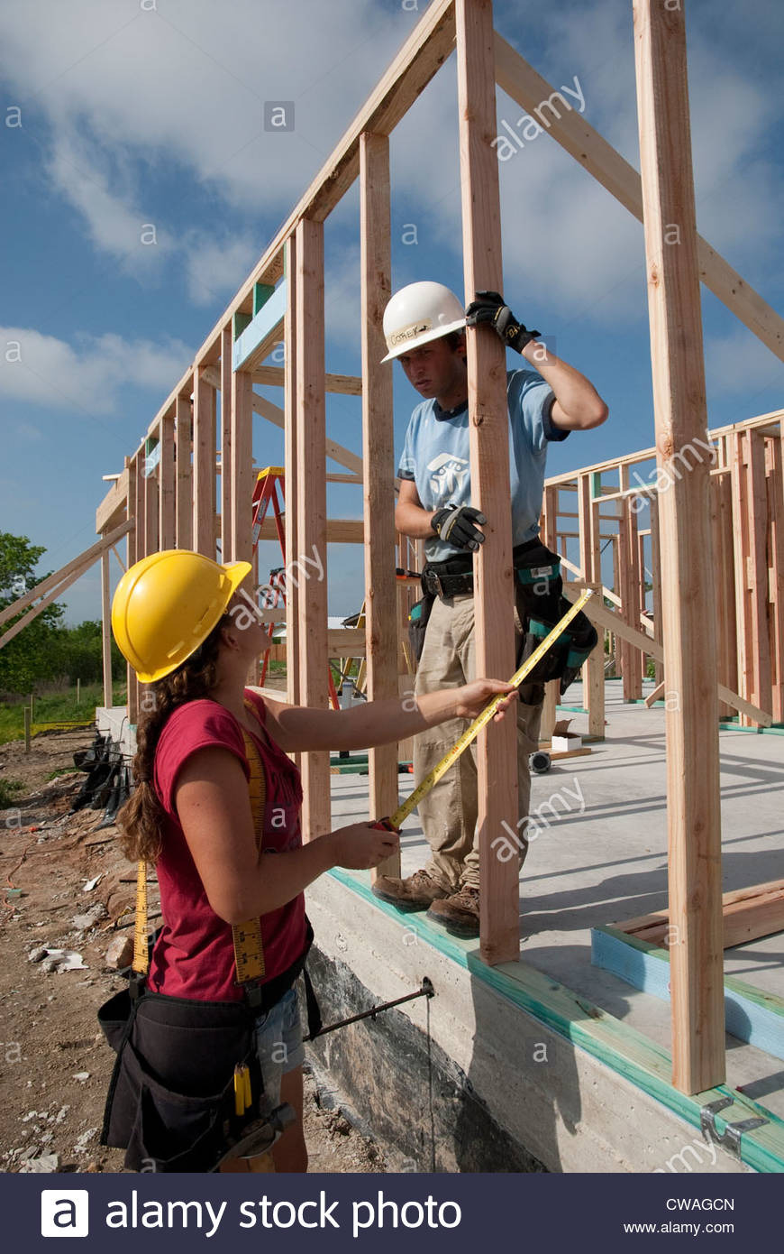 pany employees volunteer their time help build an affordable house CWAGCN
