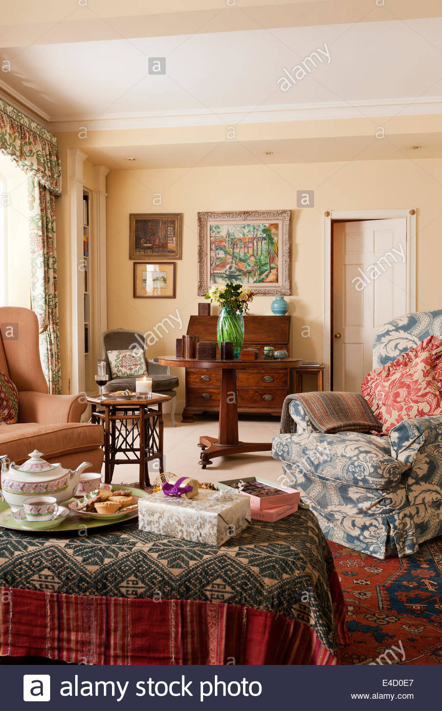 cosy sitting room with assorted antique furniture and textiles the E4D0E7