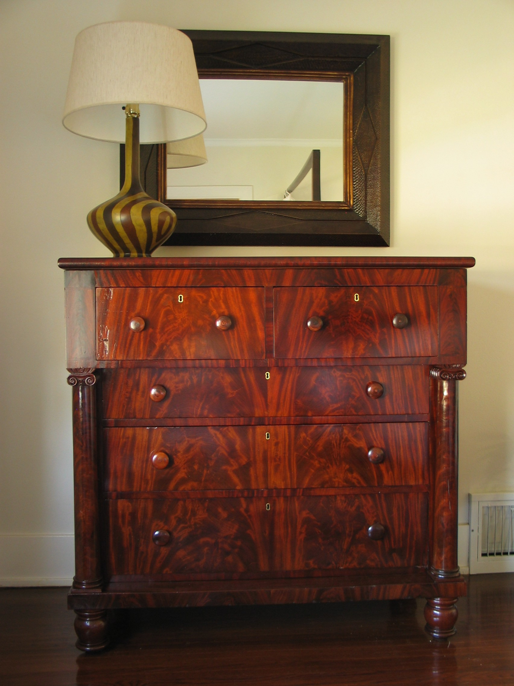 Restored mid nineteenth century Empire chest of drawers