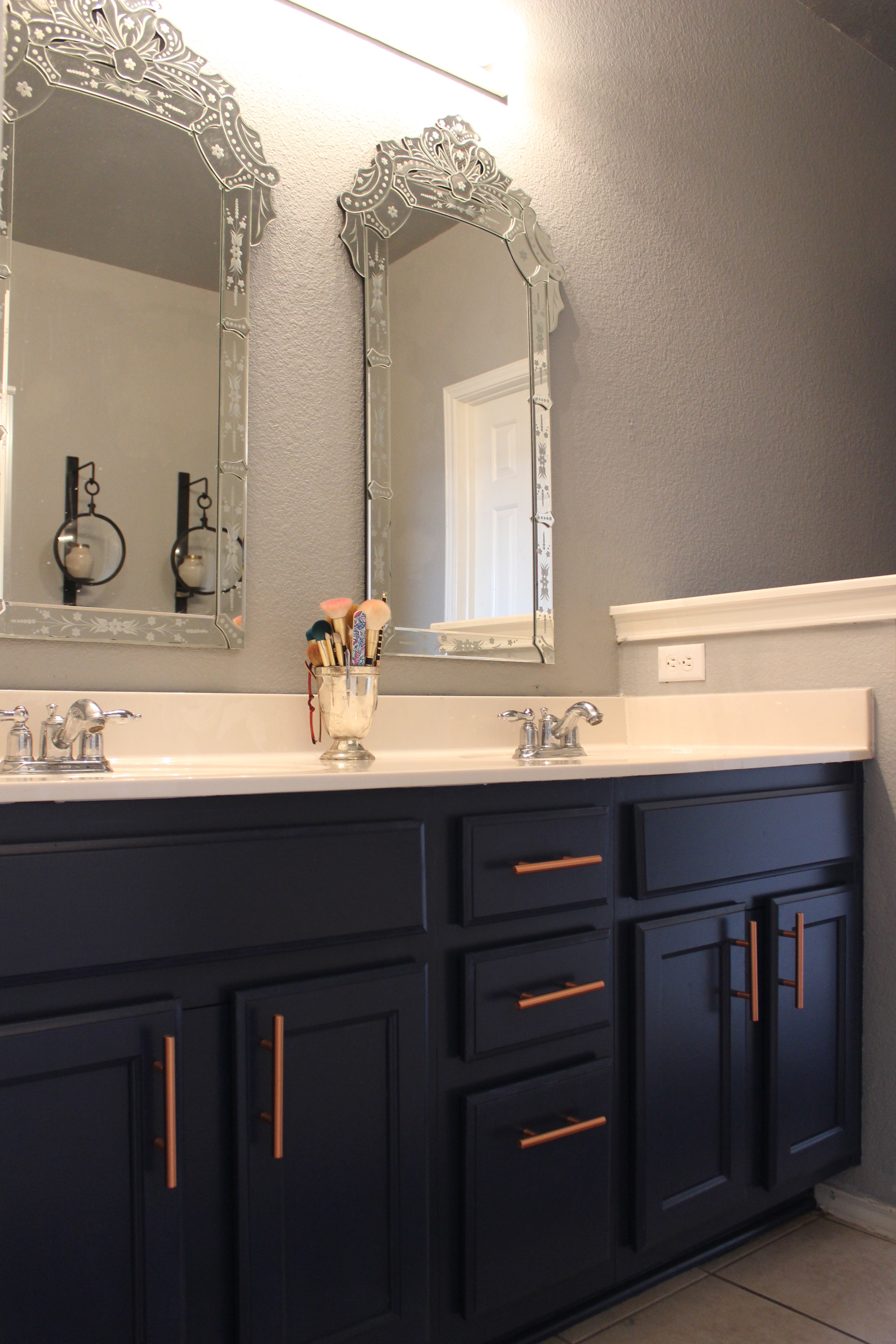navy cabinets copper hardware pulls venetian style mirrors