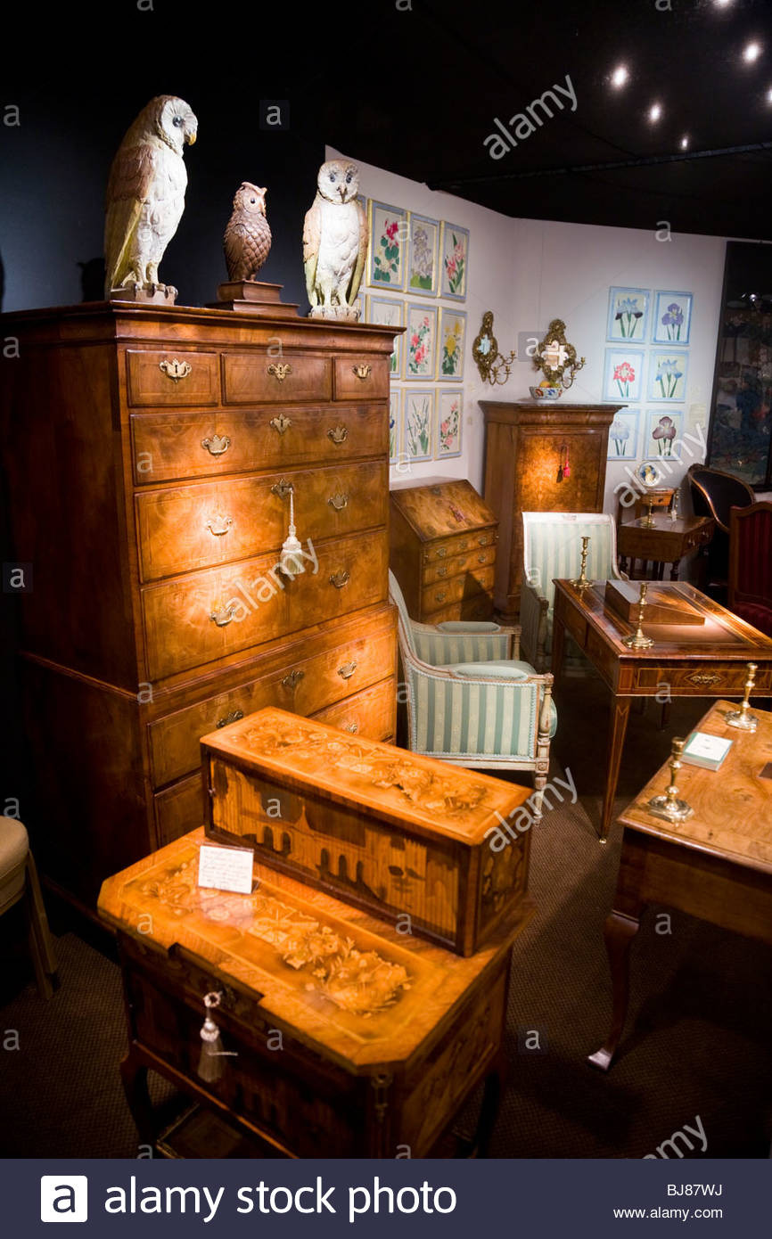 exhibitor stall selling antique furniture and ornaments at the antiques BJ87WJ