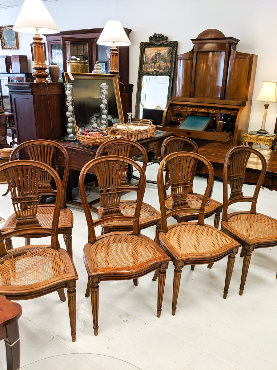 a set of seven early 1800s french provincial dining chairs