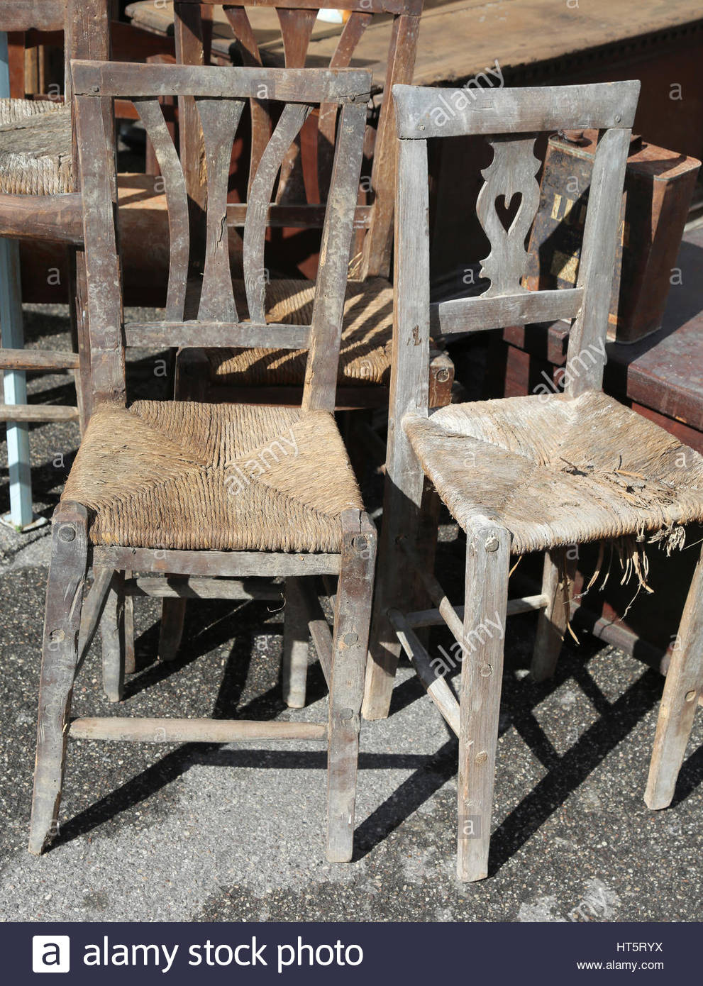 old wicker chairs for sale in the outdoor antiques market HT5RYX