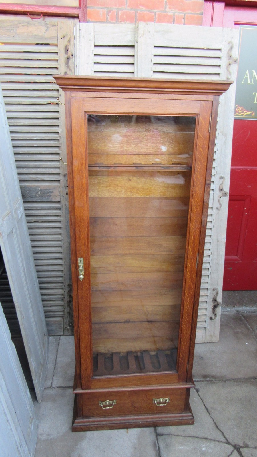 antique army and navy oak gun cabinet c1900