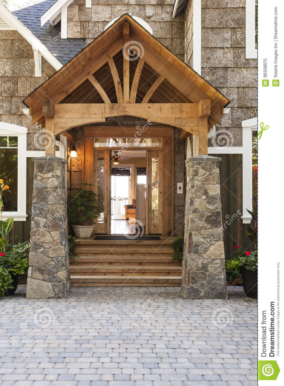 exterior porch front door entrance to beautiful upscale country house high quality wood stone building materials