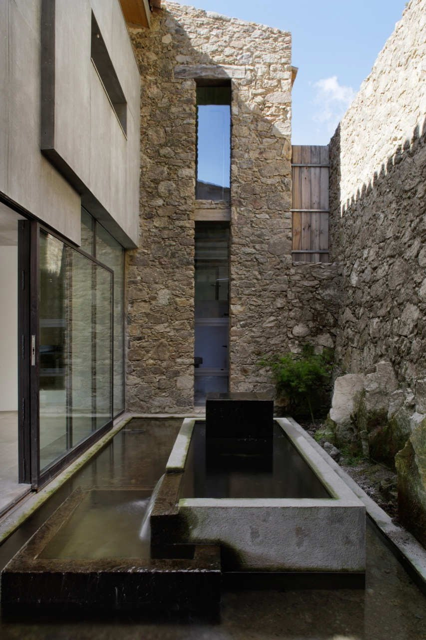 spanish stable turned contemporary stone home 8