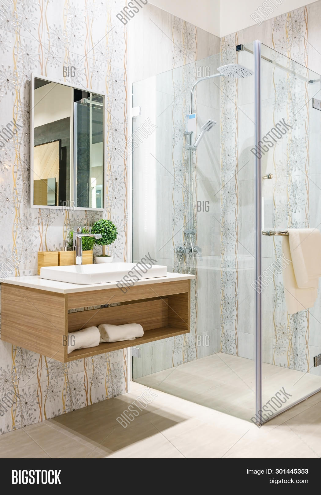 stock photo spacious and bright modern bathroom interior with white walls, a shower cabin with glass wall, a toi