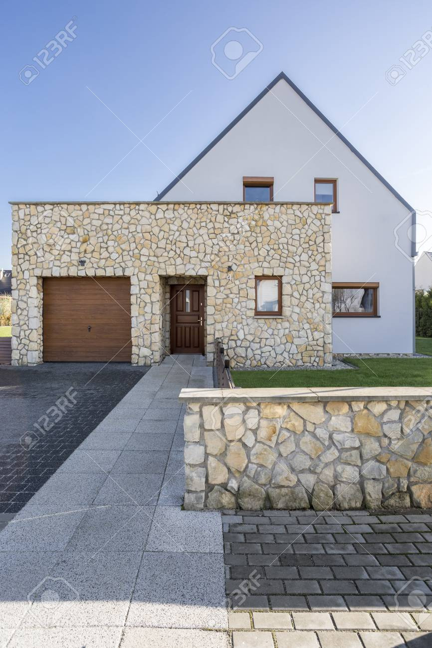 photo modern house exterior with natural stone elevation
