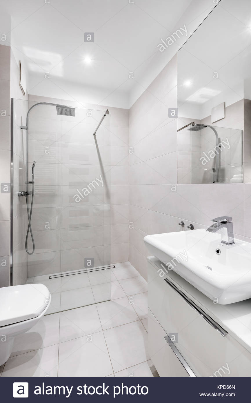 bright modern white bathroom with tiled walk in shower KPD66N