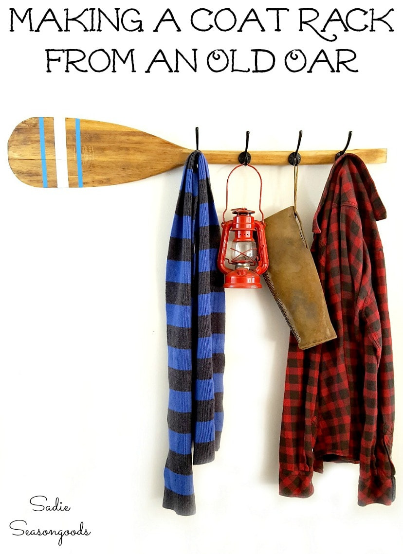 Rustic home decor with an oar or wooden paddle that is now a rustic coat rack and nautical wall decor by Sa Seasongoods