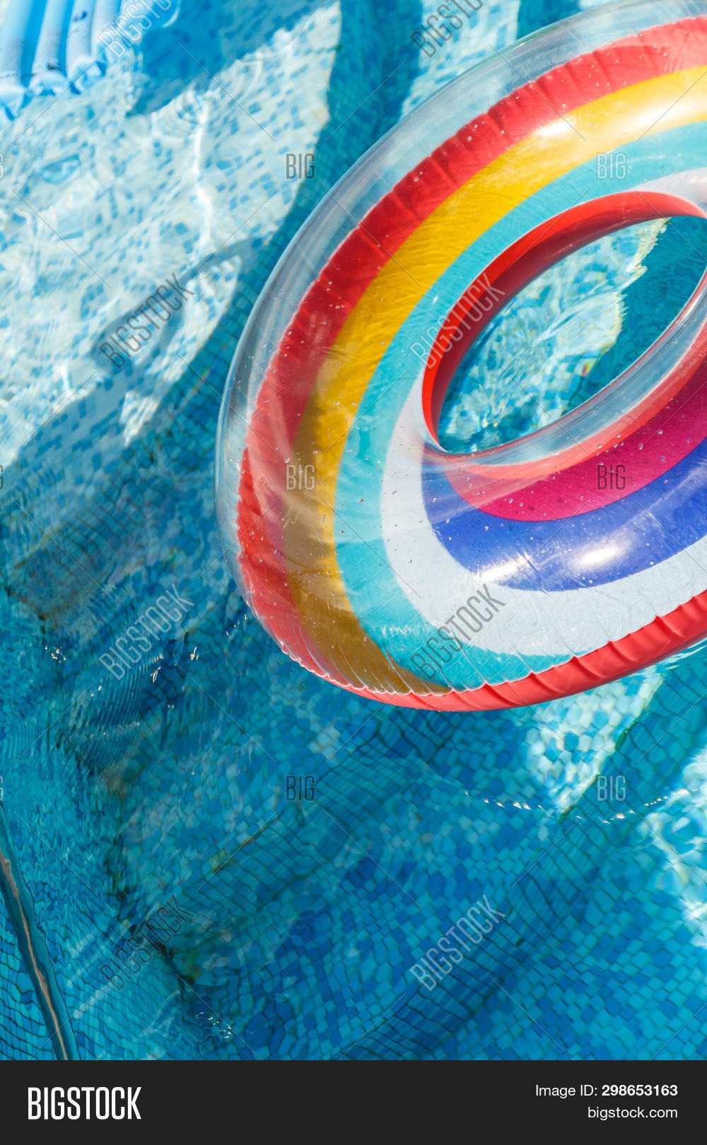 stock photo inflatable water activities circles tuba float on the water in the pool concept, fun, perky summer