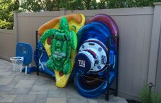 Pool Float Holder Diy Awesome New Use For Firewood Rack Just Add Some Bungee Cords To
