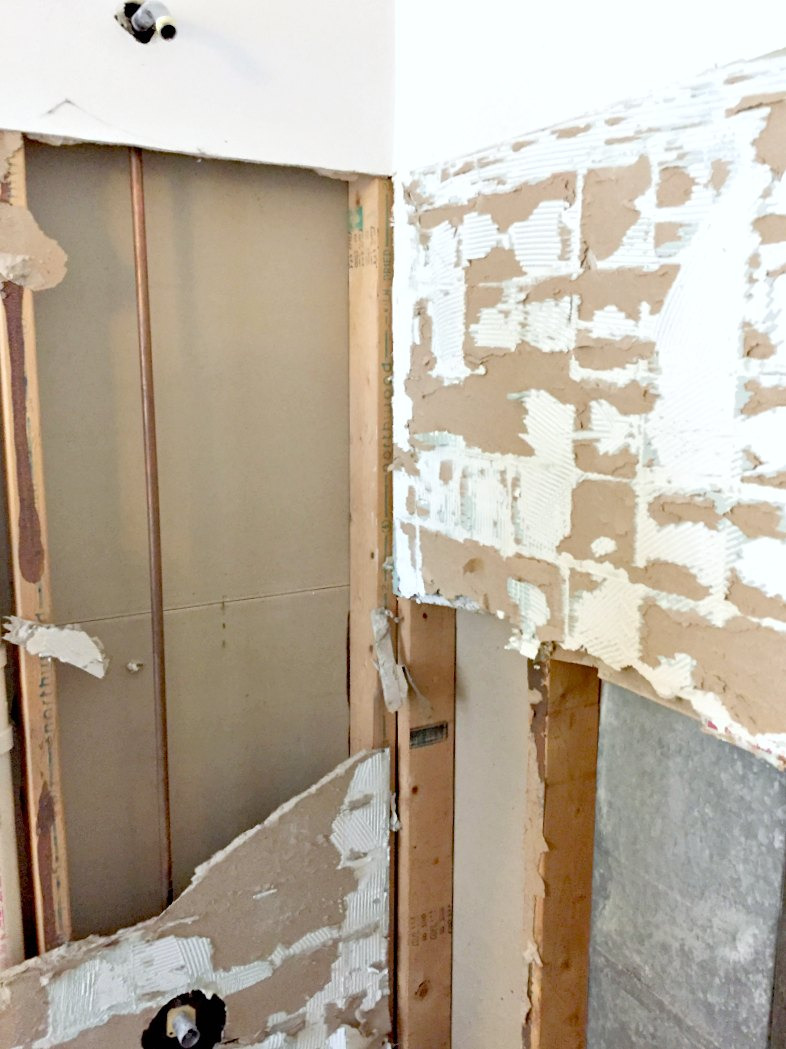 revealing studs under drywall