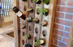 Wine Glass Rack Bunnings Inspirational Custom Upcycled Bottle Top Planters In A Unique Custom Wall