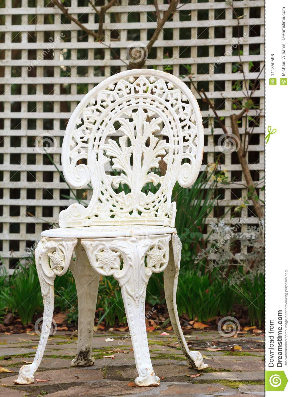 retro white metal garden chair trellis background antique style outdoor sitting courtyard filling
