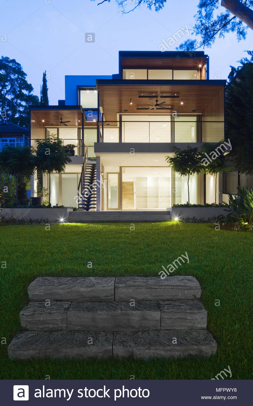 exterior of modern house at night MFPWY8