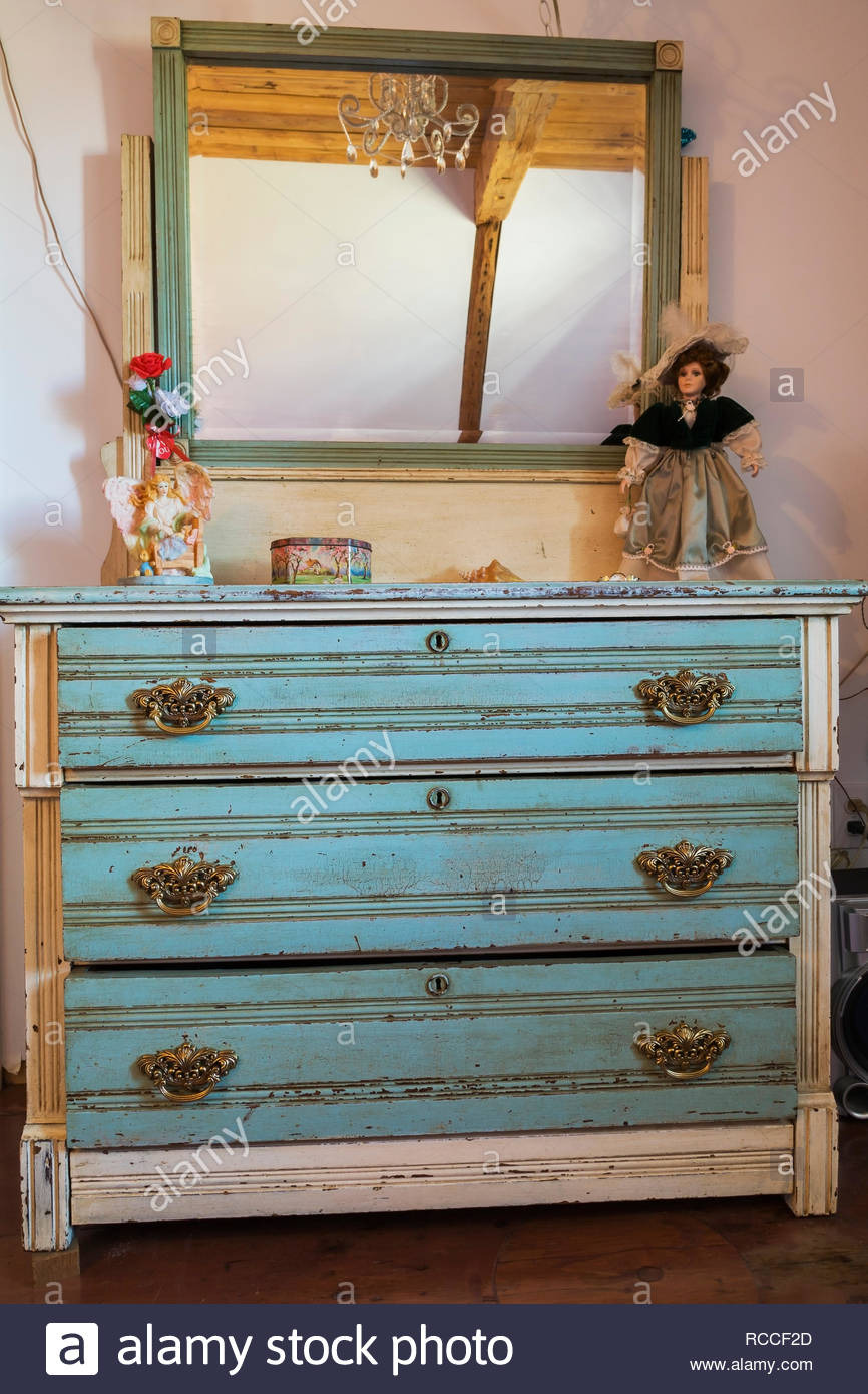 childs bedroom with blue teal antique reproduction dresser on upper floor inside an old 1835 fieldstone house RCCF2D
