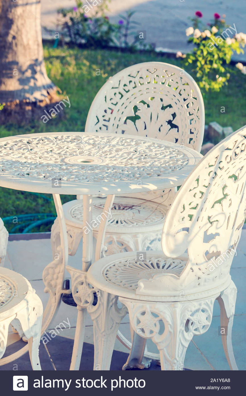 vintage wrought iron garden table and chairs in a garden 2A1Y6A8