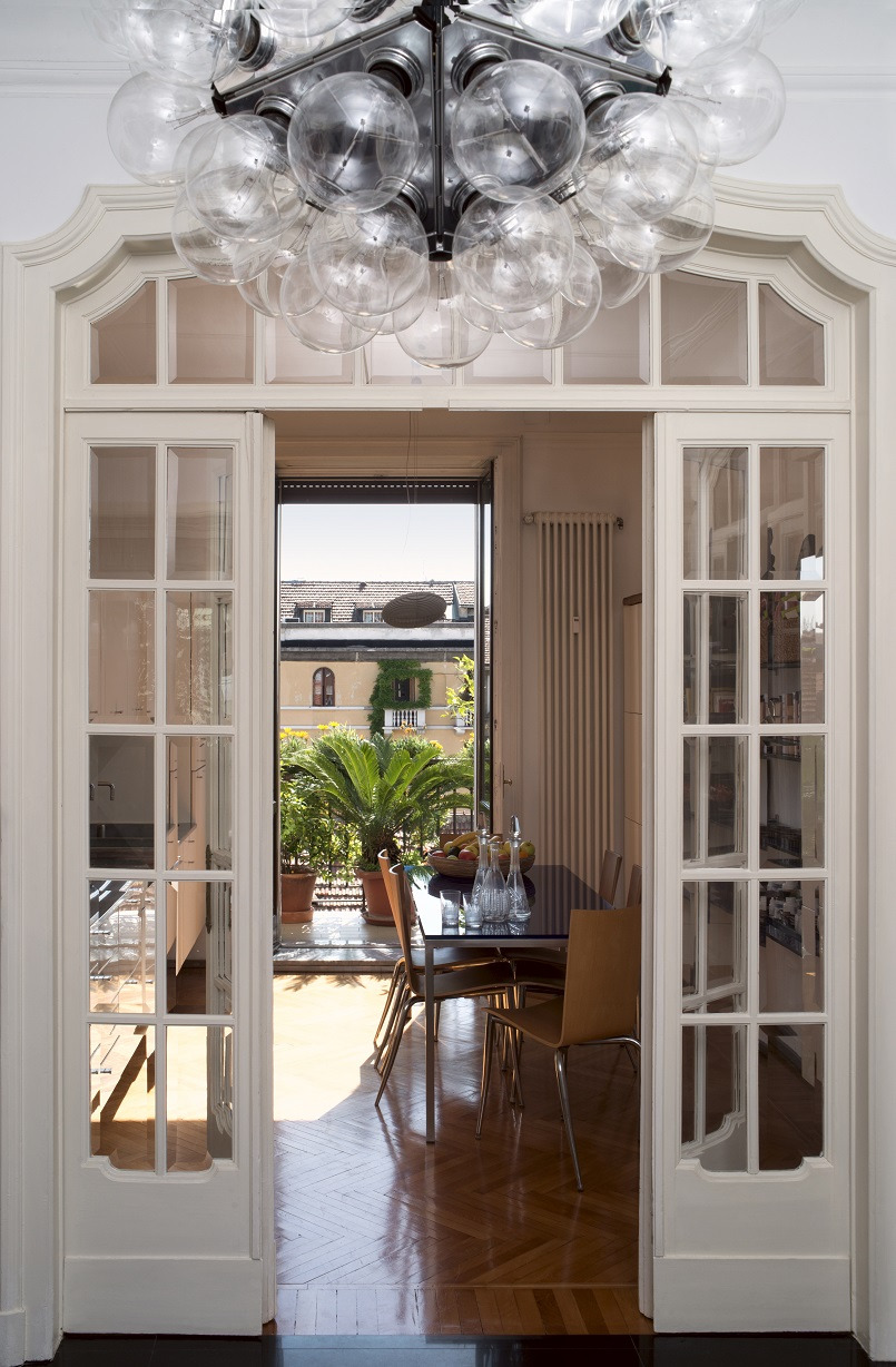 ceiling lights dining room furniture garden view family residence Milan Italy Midsummer Milano Archi living B