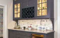 Glass Cabinet Doors Lowes Lovely Concealed Behind This Elegant Storage Unit Is Everything You