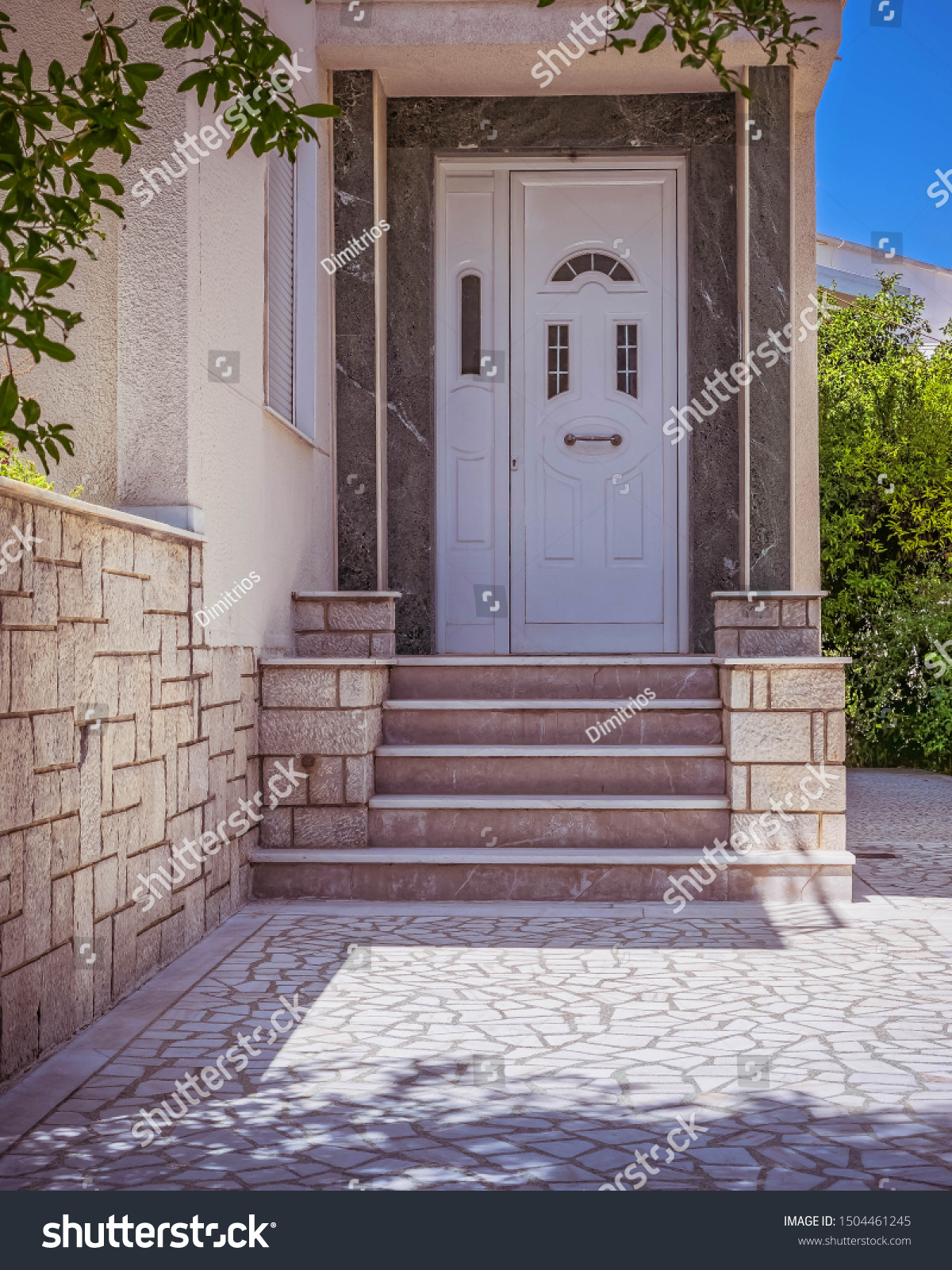 stock photo family house entrance stairs and white door athens greece