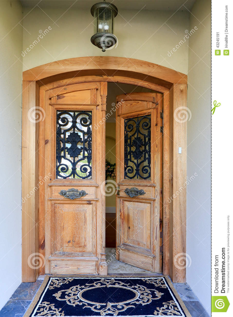 luxury house entrance porch open door wooden wrought iron details