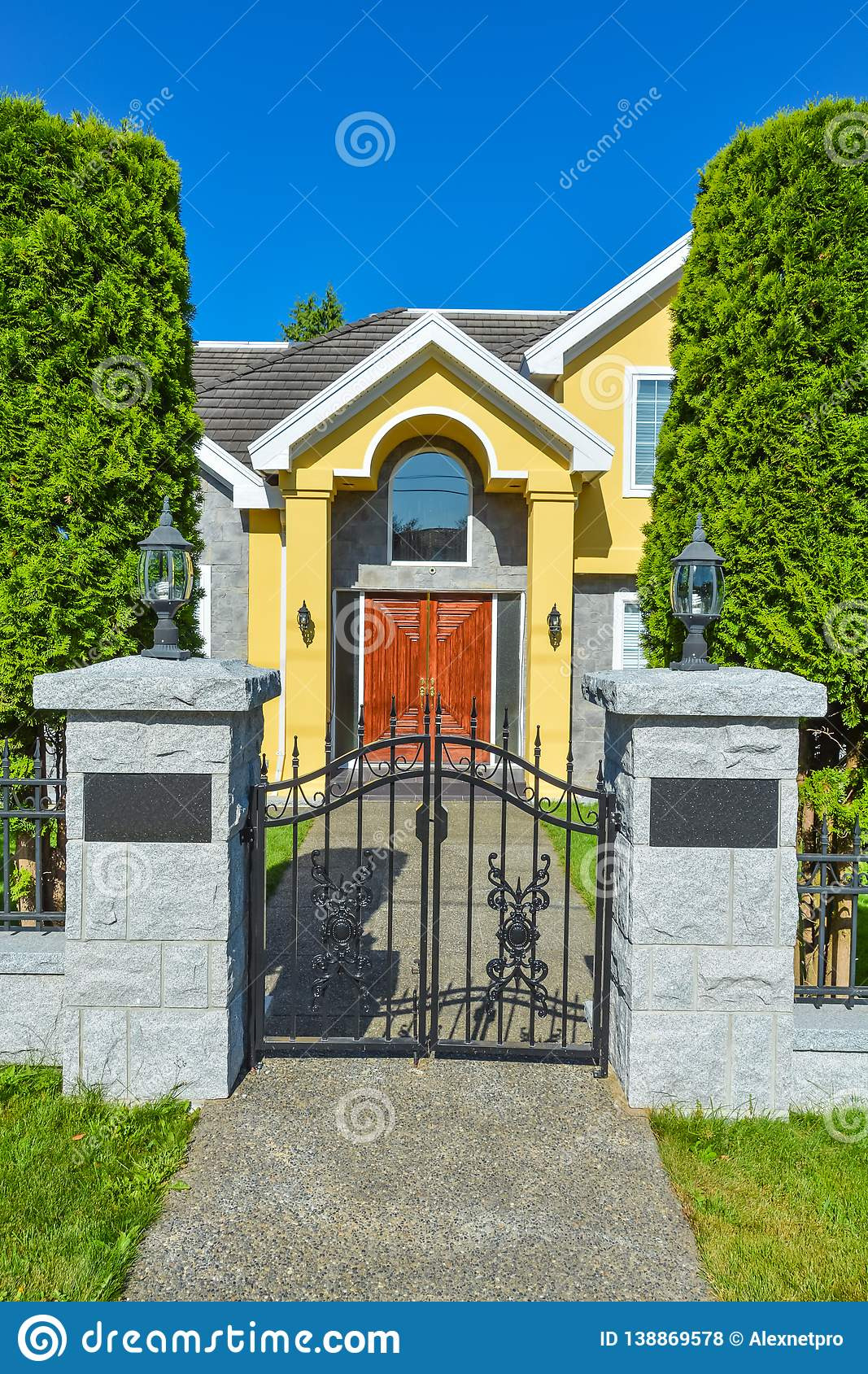 entrance luxury family house cast iron gates front vancouver canada