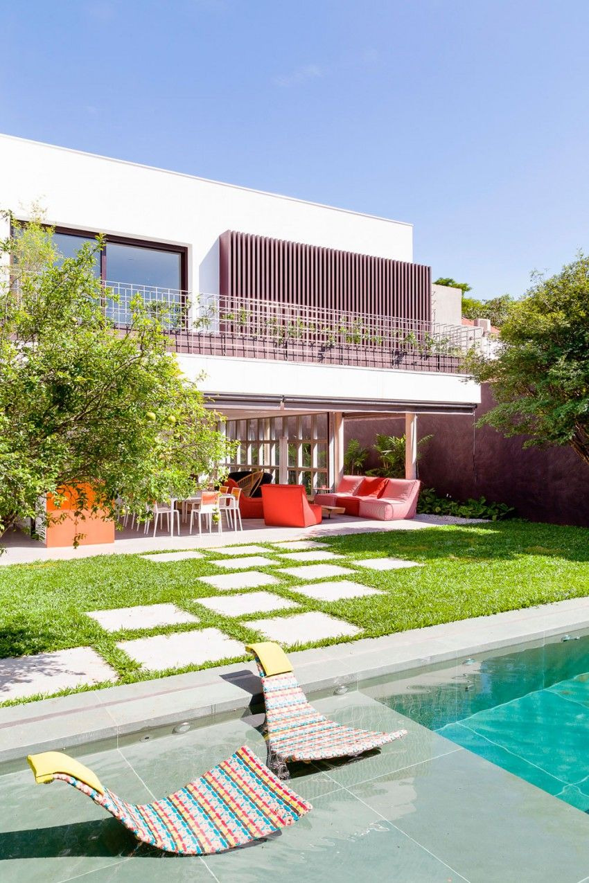 Backyard small swimming pool and a modern lawn with concrete pavers