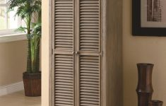 Tall Storage Cabinets With Doors Awesome Unpolished Shutter Door Tall Storage Cabinet Placed Cream