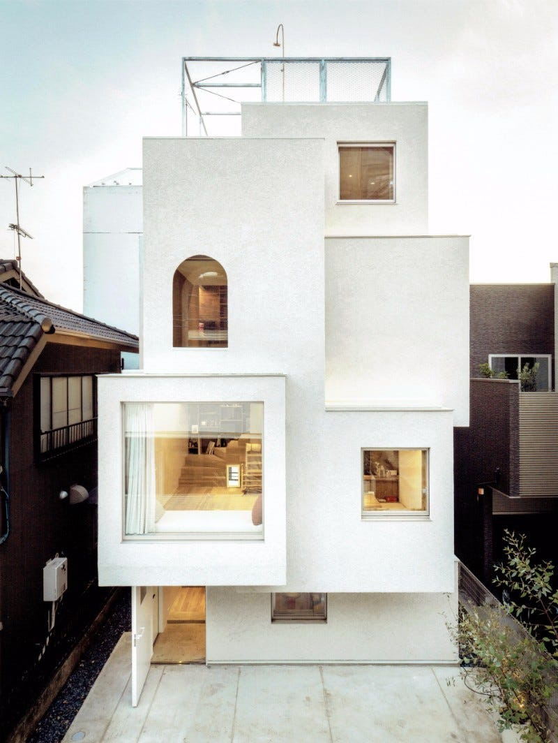 in a narrow alley in tokyo japan the house in the city features rooms in a staggered arrangement it stretches four floors so the family who lives there has plenty of room