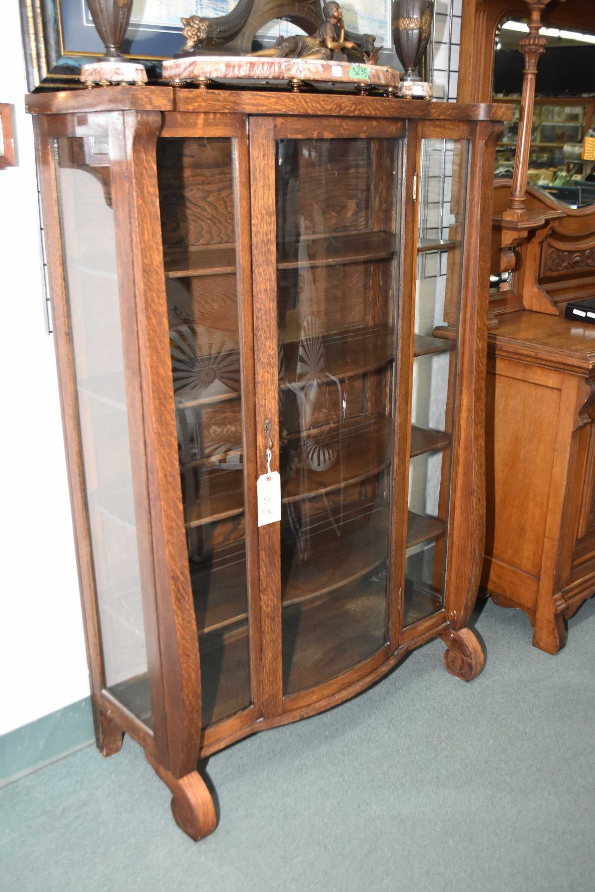 Antique quarter cut oak Empire style display cabinet with glass side panels and curved glass door i