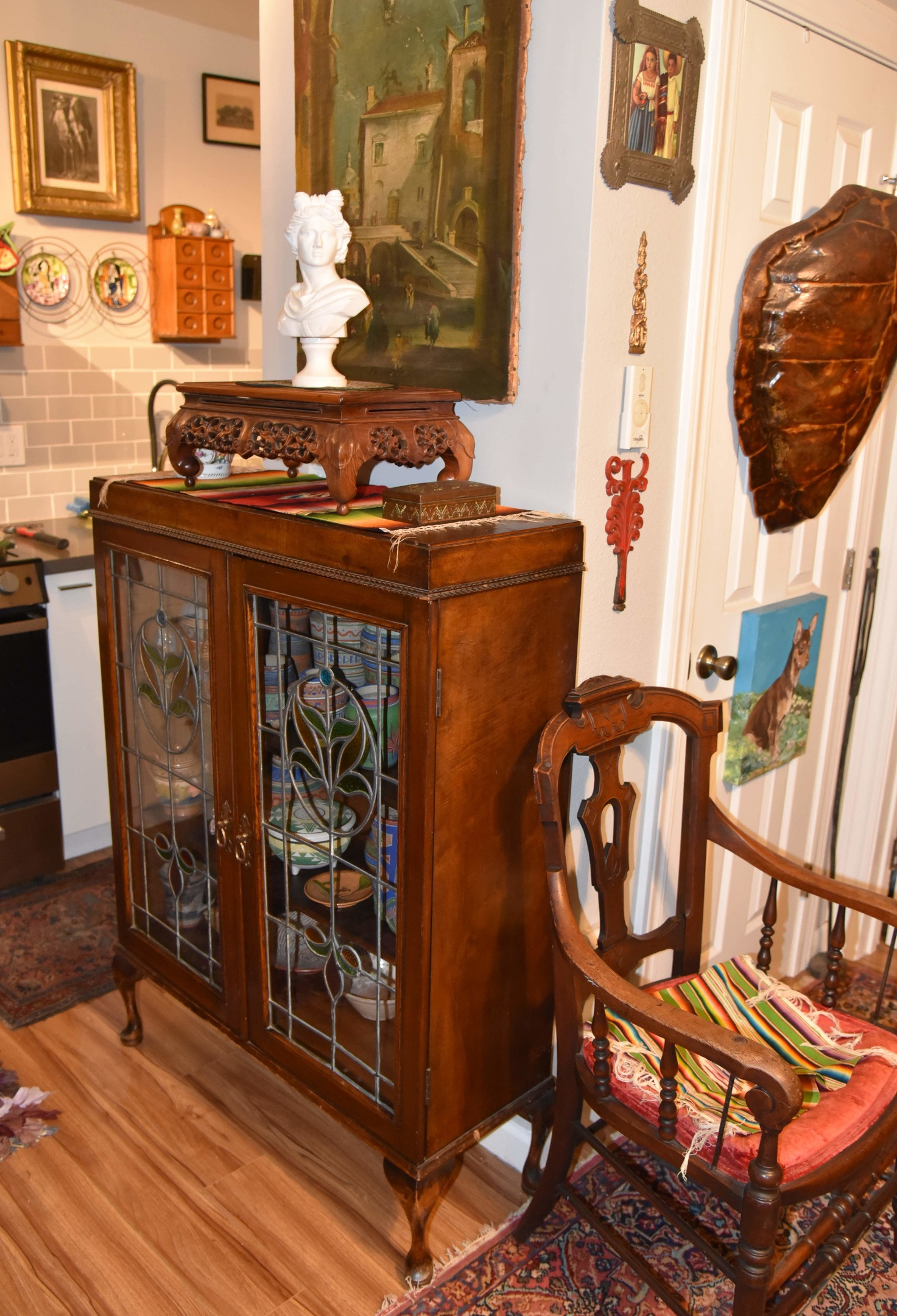 antique china cabinet with stained glass in=activity