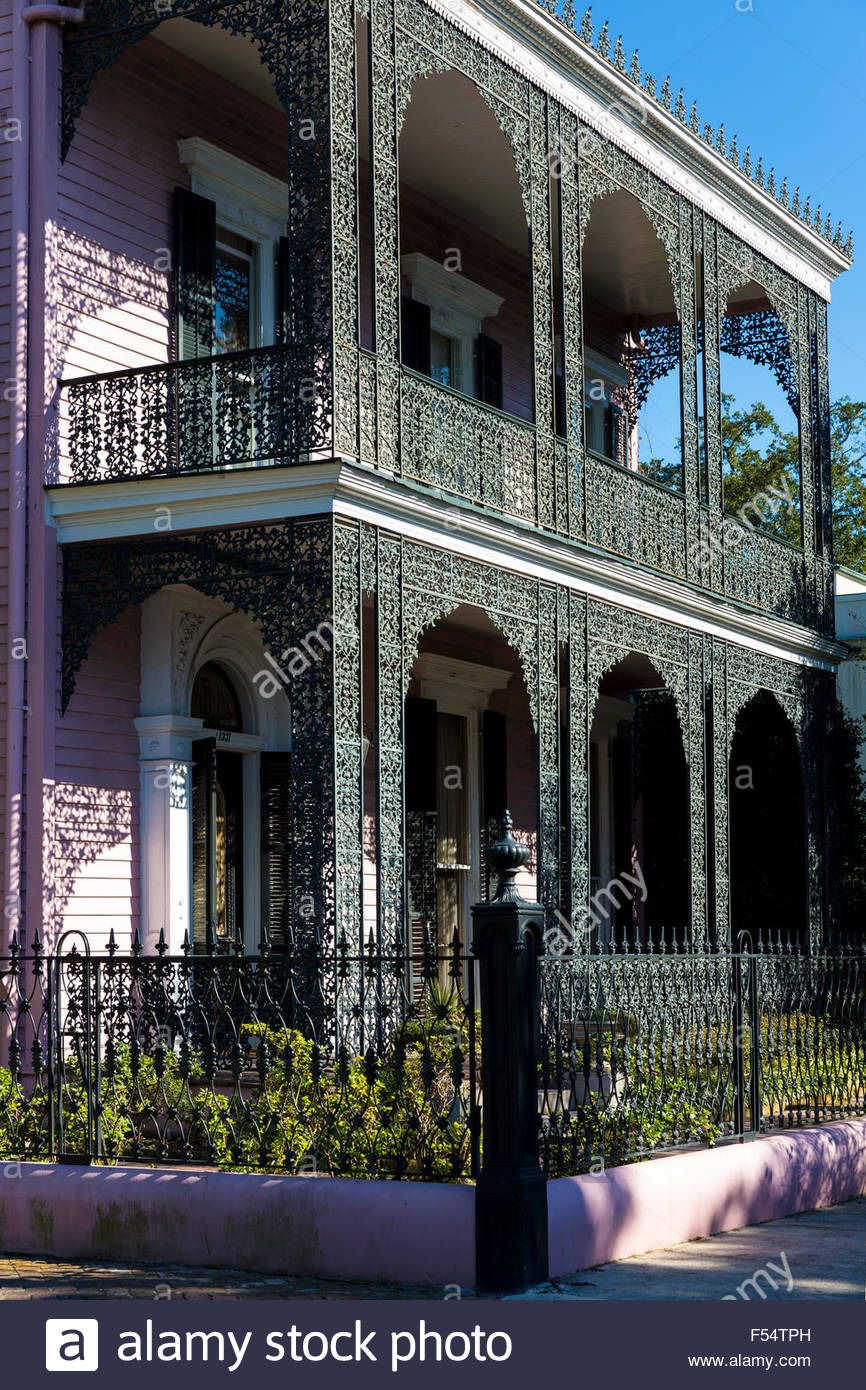 grand mansion house ornate lacy iron balcony and double gallery in F54TPH