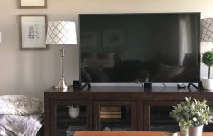 Tv Cabinet With Glass Doors Elegant Tv Console With Glass Cabinet Doors In A Basement Media Room