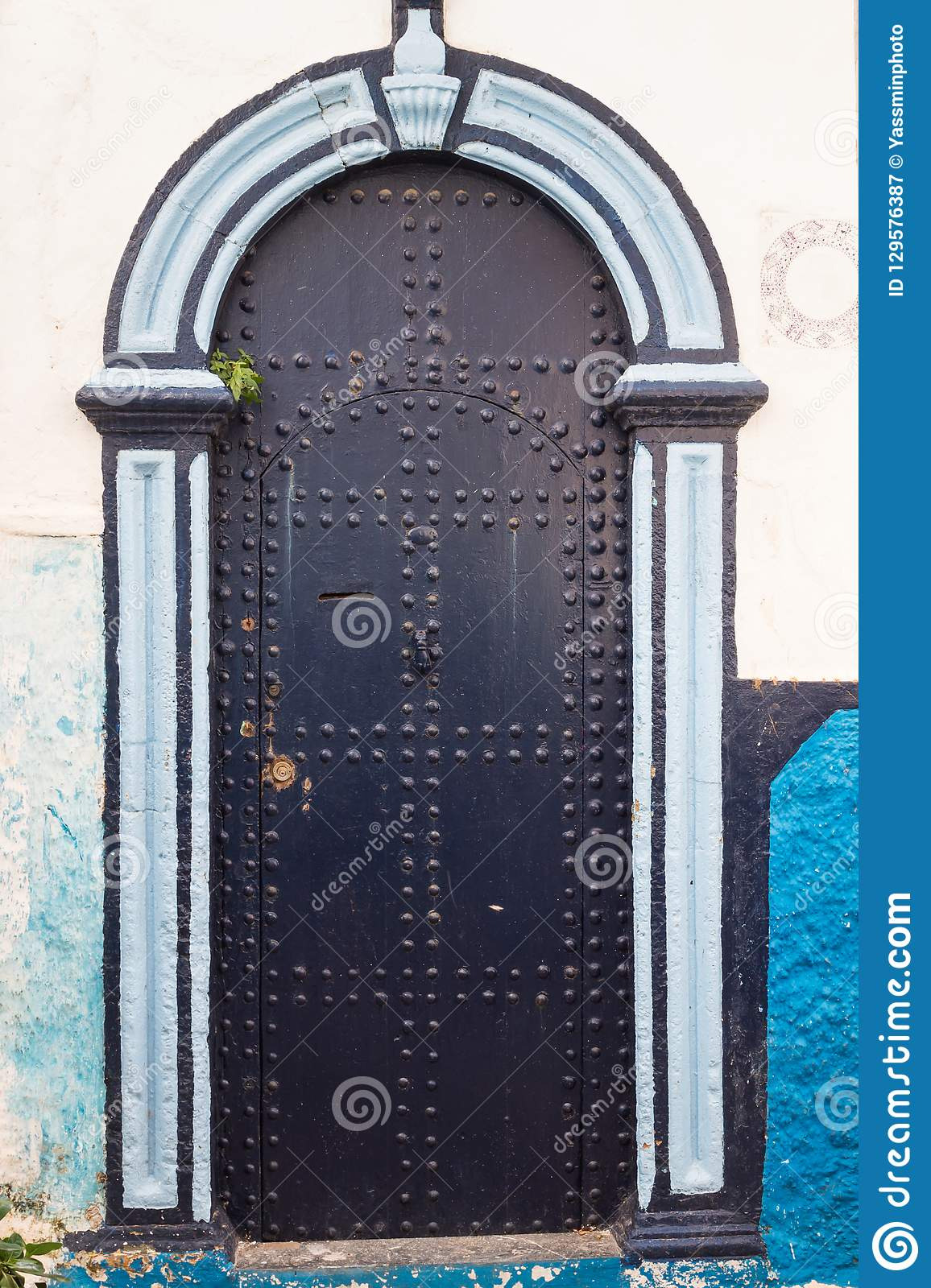 street house bright blue white color bination facade black detail wooden gate street kasbah de