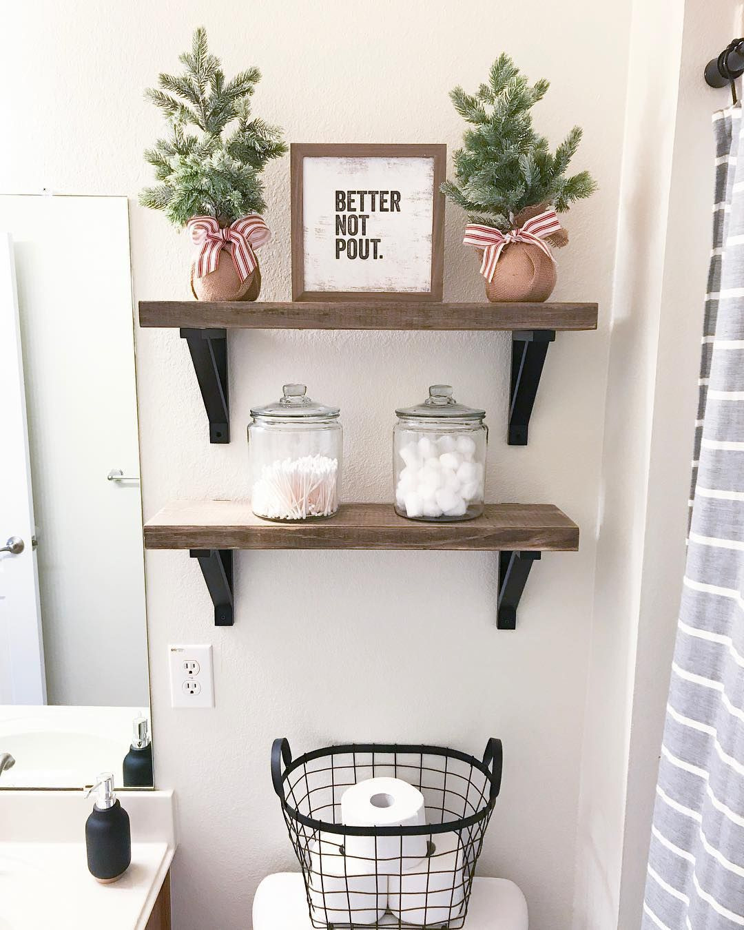 Christmas Decor on the Toilet Shelving in Bathroom via simply sweet designs