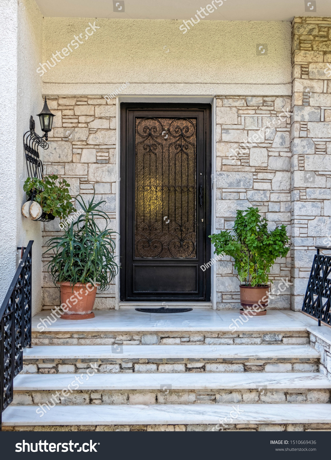 stock photo contemporary house entrance stairs to metal and glass decorated door athens greece