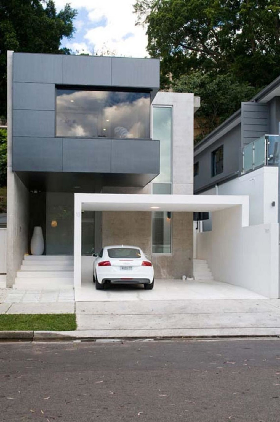 minimalist house architecture with black facade design color equipped with garage design outdoor