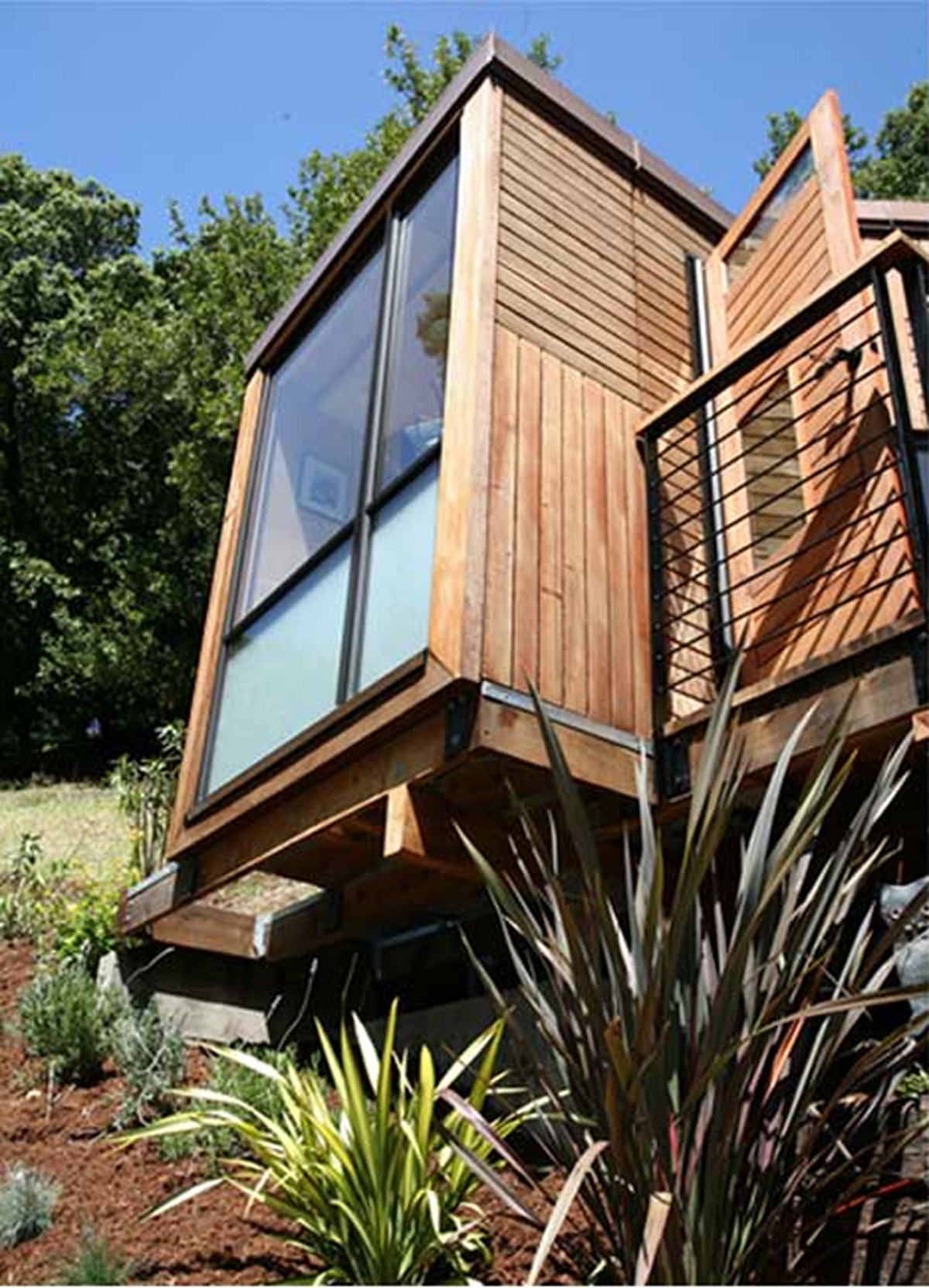 Sustainable Small House with Modern Design and Wooden Finishing Windows