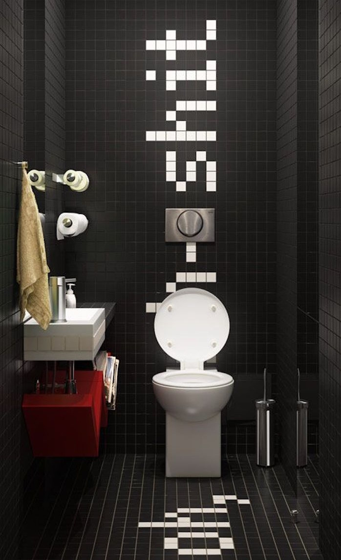bathroom remodel toilet entirely covered in small black tiles with several white tiles spelling out a humorous message round white toilet seat black white and red sink