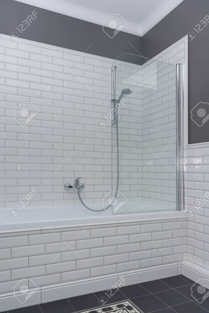 photo bathroom interior close up the walls are painted gray covered with decorative ceramic tiles with whi