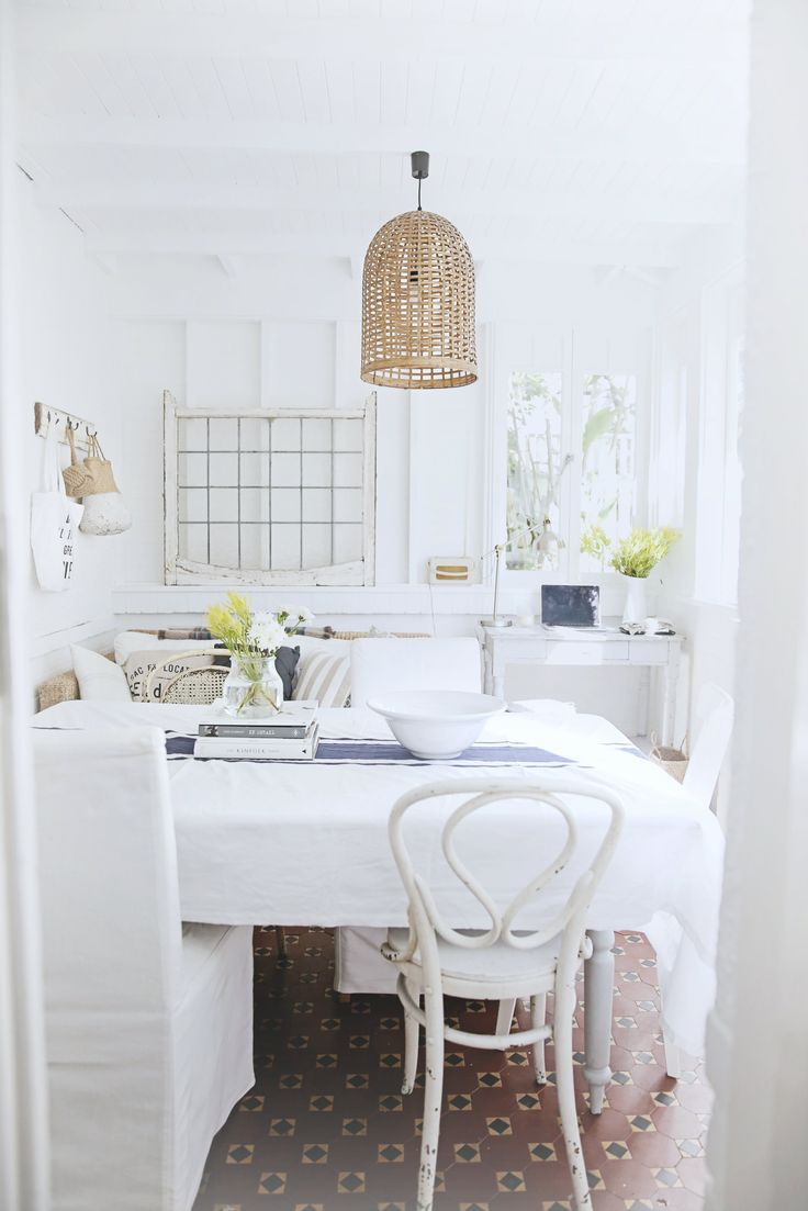 naturally lit open space with white decor and natural accents