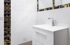 Decorative Tiles For Bathroom Beautiful White Bathroom With Decorative Black And Gold Tiles On Wall