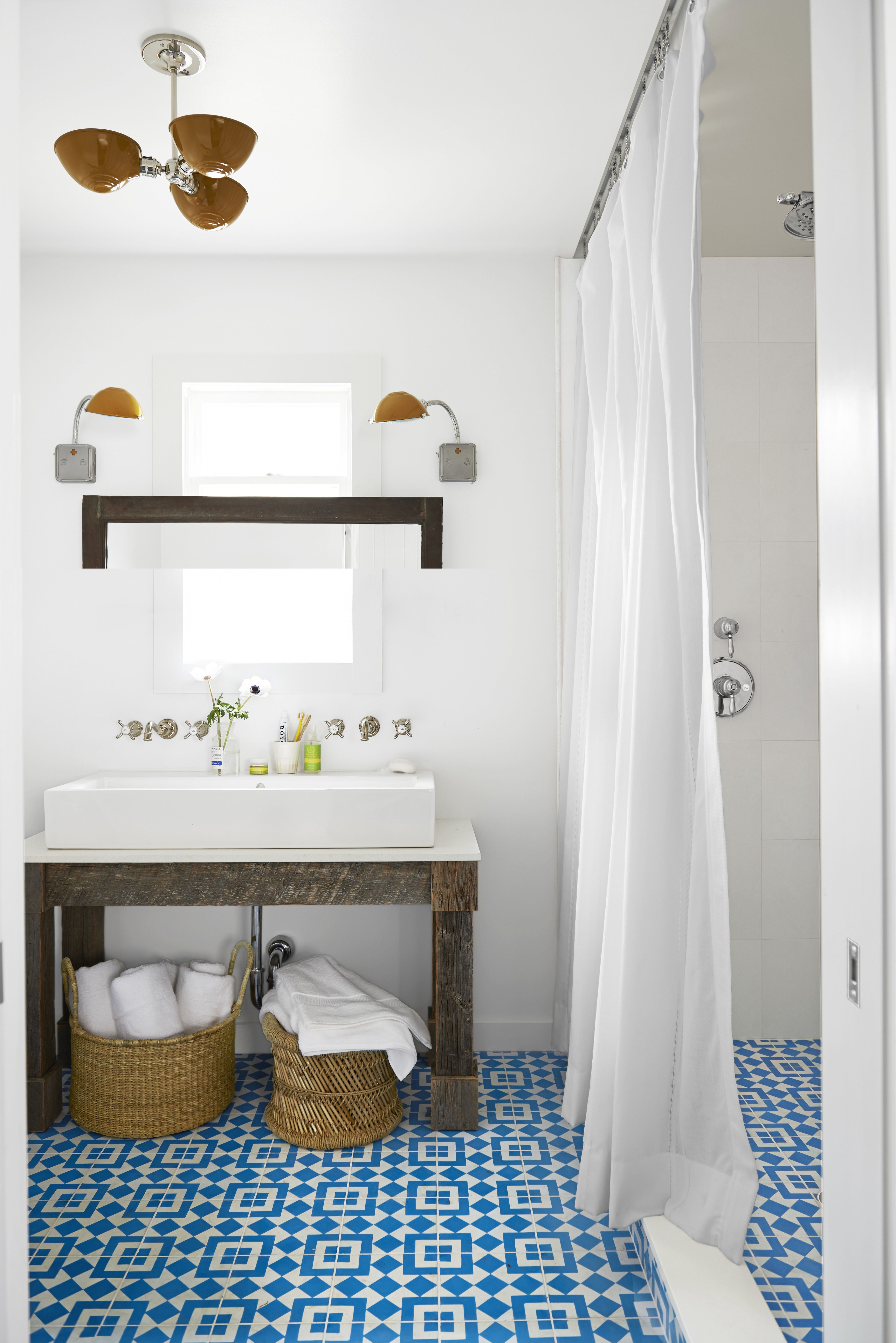 blue tiled bathroom storage baskets